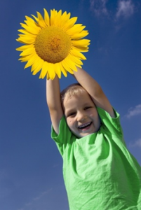 smiling_boy_with_sunflower