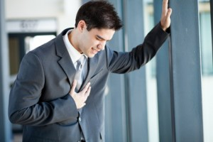 young businessman having chest pain